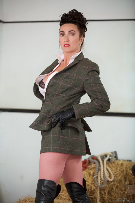 Miss Hybrid Tweed mistress, sexy leather boots and gloves and easy access nylons.