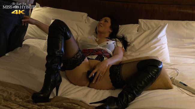 Miss Hybrid anal stretch in thigh boots and stockings.