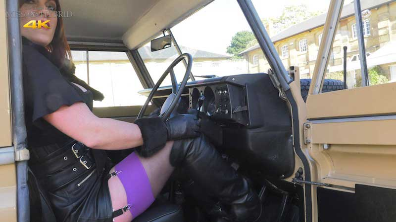 Miss Hybrid stockings, boots, gloves and no knickers in her newly restored Land Rover.