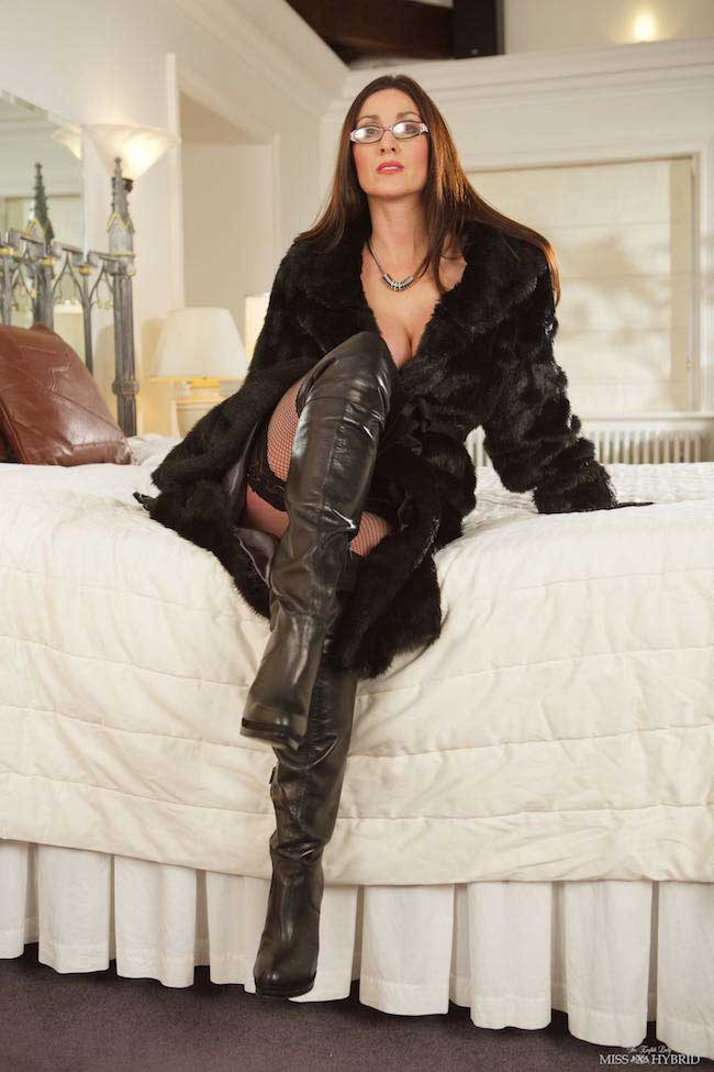 Miss Hybrid leather boots and stockings with fur coat.