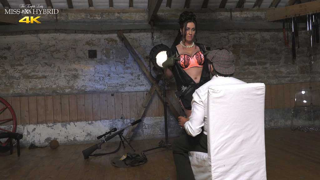 Miss Hybrid strict boss in sexy linerie, stockings and boots in the Manor dungeon.