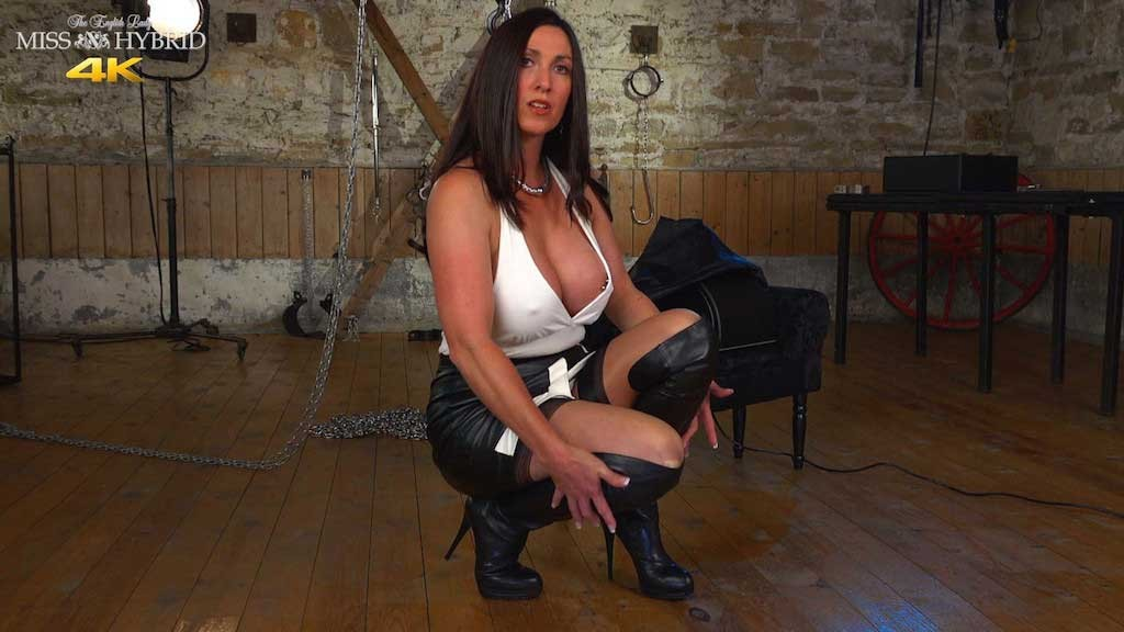 Miss Hybrid leather Sybian ride in thigh boots and stockings in the dungeon.