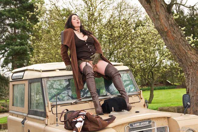 Miss Hybrid country Lady thigh boots and glass dildo outdoors.