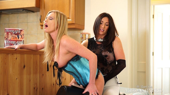 Holly Kiss nipple tassels and strapon fucked by Miss Hybrid