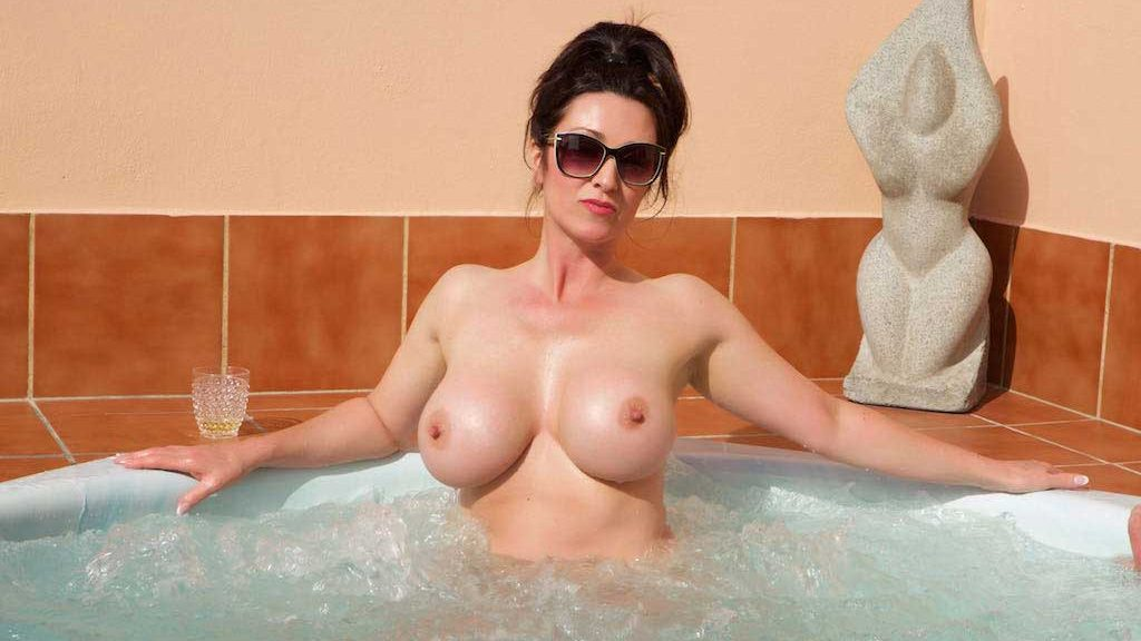 Miss Hybrid huge tits and hard nipples playing in the hot tub.
