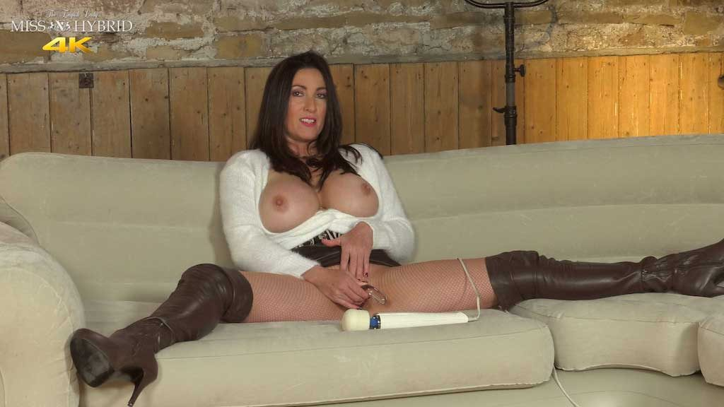 Miss Hybrid fishnet squirt, teather boots and short skirt, huge tits and wet pussy.