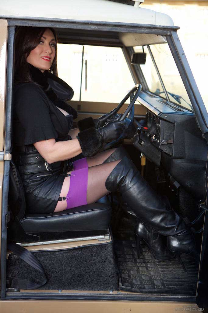 Miss Hybrid leather gloves, sexy leather skirt and leather thigh boots.