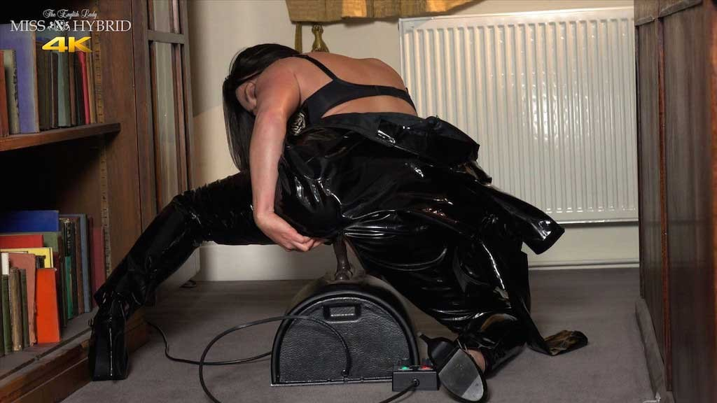 Miss Hybrid latex catsuit unzipped Sybian ride.