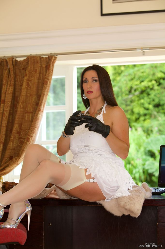 cock cage, miss hybrid, stockings, nylons, stilettos, leather gloves