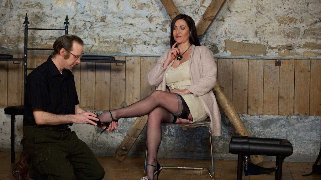 Miss Hybrid stockings and heels foot wank in the dungeon.