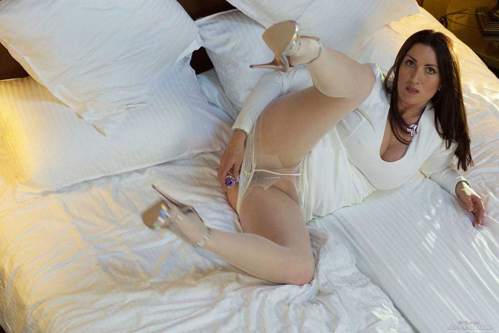 Miss Hybrid sky high heels pantyhose playing on the bed.