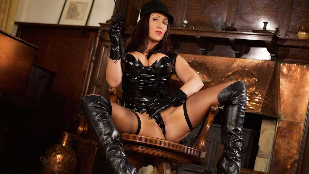 Miss Hybrid kinky riding mistress leather thigh boots and tight latex top.
