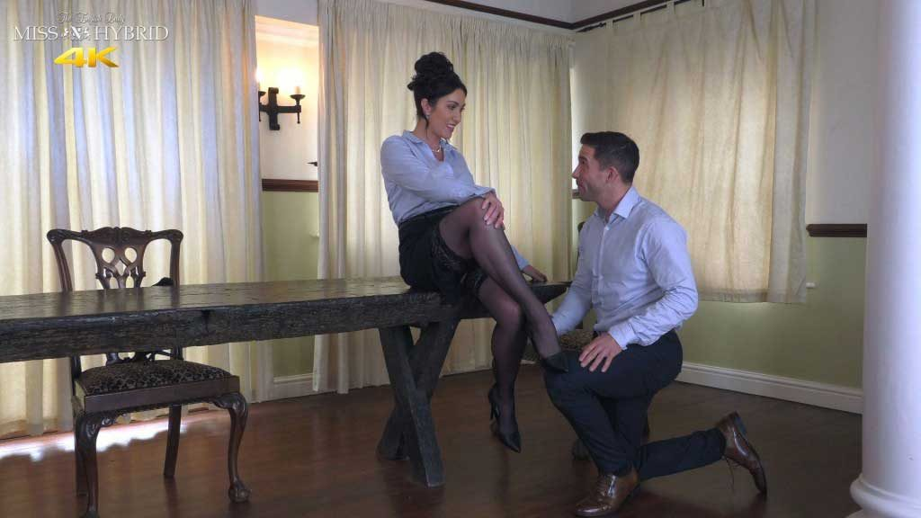 Miss Hybrid sexy nylons, huge tits and high heels takes her new PA in hand.