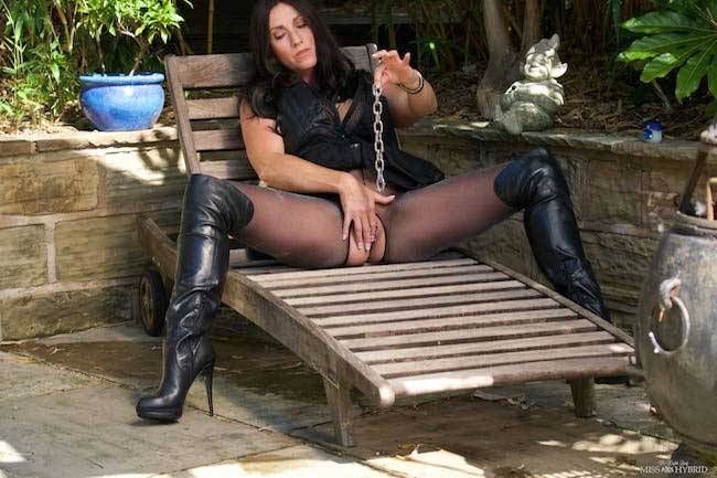Miss Hybrid chained pussy thigh boots and pantyhose outdoors chaining her pussy.