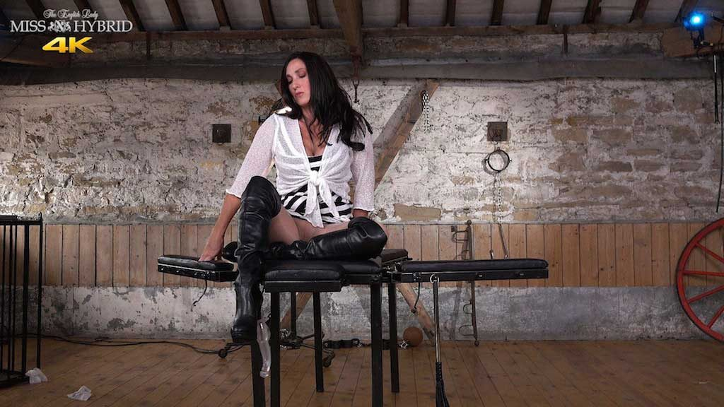 Miss Hybrid leather booted mistress pantyhose and thigh boots.