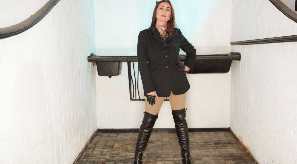 Miss Hybrid silk pussybow blouse, leather thigh boots and Ralph Lauren jodhpurs in the stables.